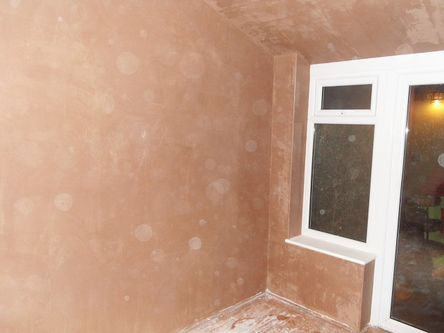 Finished plaster walls to the conservatory.