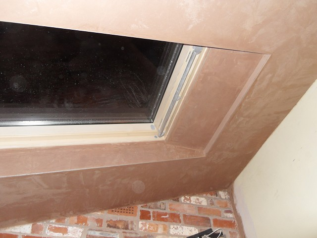 Finished plaster around ceiling Velux skylights.