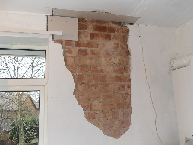 Loose plaster removed from wall.