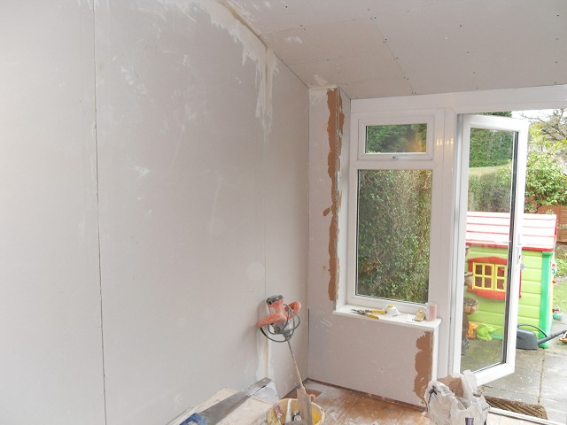 Dot 'n' dab plasterboard fixed to walls.
